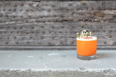 Jessica Rabbit | 1.5 oz. Big Gin | 2 oz. carrot juice | 1 oz. lime-ginger oleo | 1 oz. lime juice | .5 oz. Kummel | .5 oz. yellow chartreause | 4 drops carrot top oil